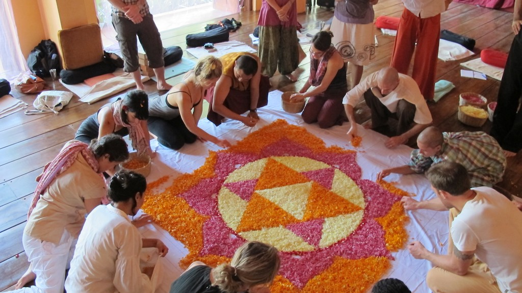 Yantras are graphical devices used traditionally by yoga practitioners to help to still the mind in meditation. We managed to do this quite well (forty yogis is still a lot of humans with opinions)...step by step we colored in the yantra with flowers...